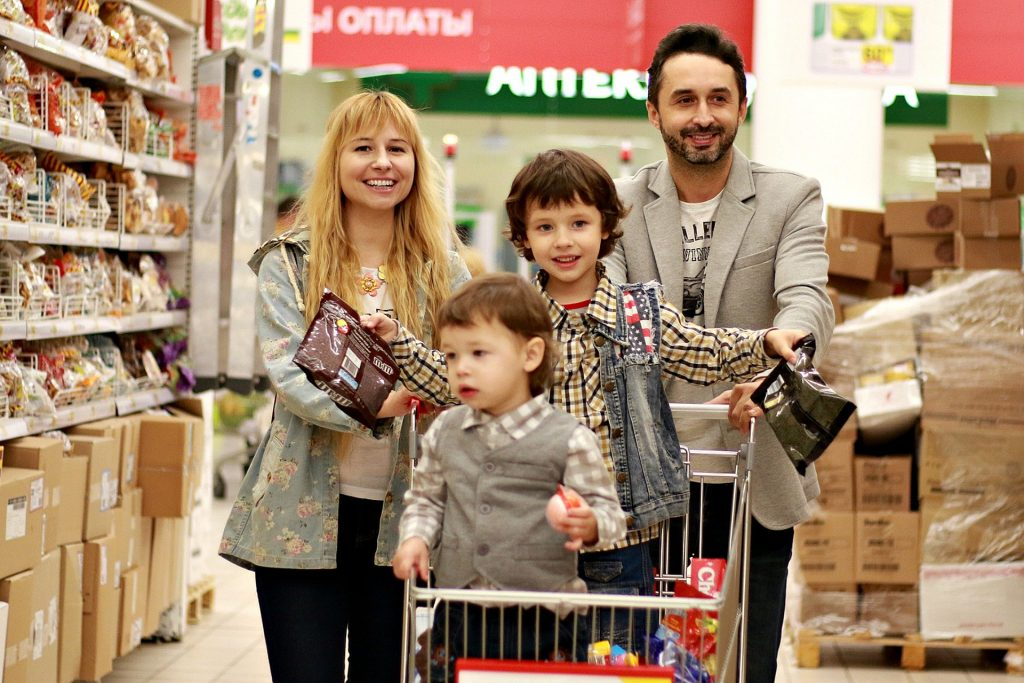 Happy family shopping with their toddler